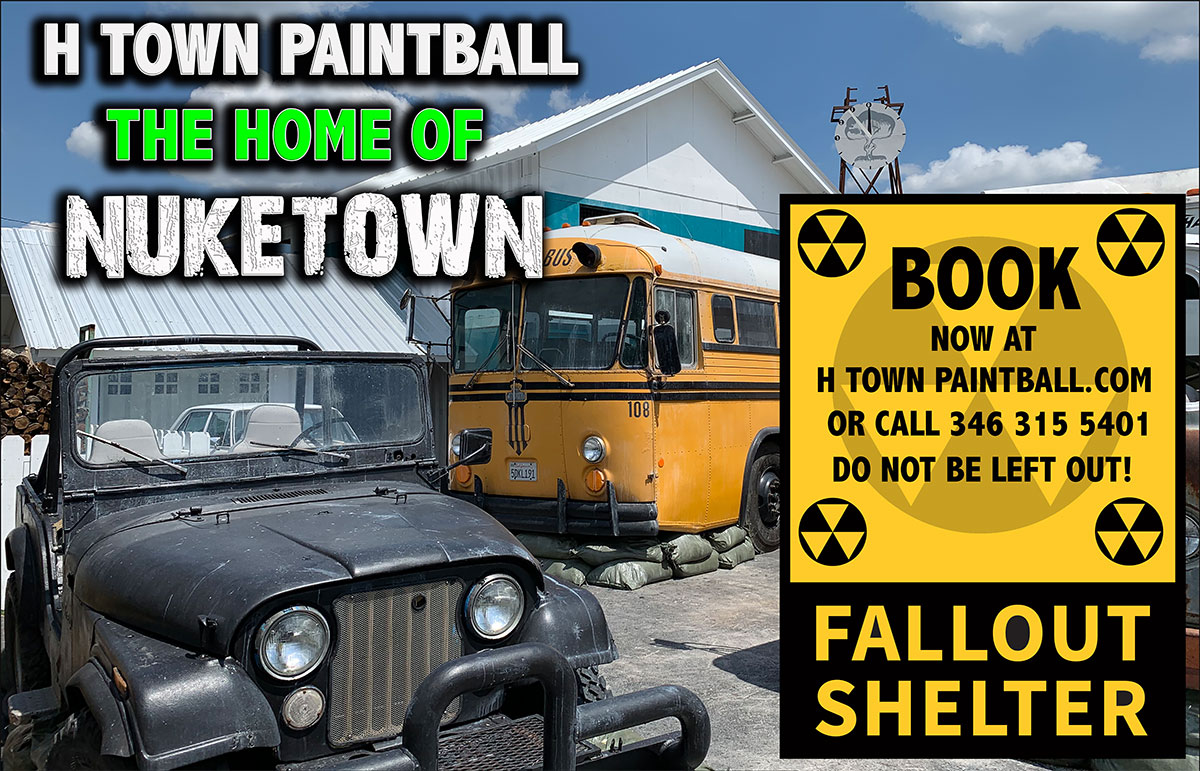 Image showing a jeep and bus in between 2 houses that serve as the paintball arena made out to look like the Call of Duty Map Nuke Town.